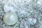 Christmas decorations. New Year ball in tinsel and spangles. — Foto de Stock