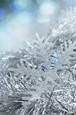 Christmas decorations. New Year snowflake in tinsel and spangles — Stock Photo