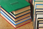 Stack and a number of books on a wooden surface. — Stock Photo