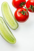 Tomatoes and cucumbers — Stock Photo