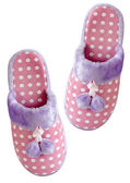 Cozy pink slippers — Stock Photo
