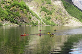 Group of people in kayaks floating in the Sognefjord — Stockfoto