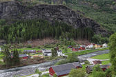 Village on the banks of a small mountain river, Norway — ストック写真