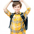 The schoolboy with books stack on head — Stock Photo
