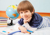 The boy with globe and notebook — Stock Photo