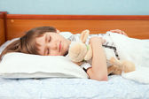 The sleeping boy with soft toy — Foto Stock