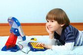 The small child work at toy computer — Stock Photo