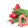 Bouquet of red tulips with sugar heart — Stock Photo