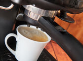 Preparation of espresso by coffee maker — Photo