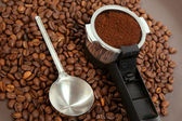 The coffee brewer handle with grised beans — Stock Photo