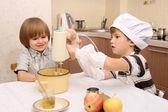 Two children cook on kitchen — Stock Photo