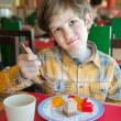 Capricious boy in restaurant — Stock Photo #42849615
