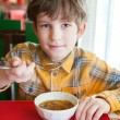 The boy in asian restaurant — Stock Photo
