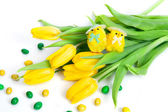 Funny artificial chickens with tulips — Stock Photo
