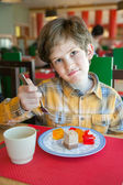 Capricious boy in restaurant — Stock Photo
