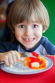 The fun boy in restaurant — Stock Photo