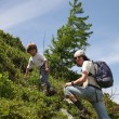 Two people hike on mountain slope in summer time — Stock Photo #43586927