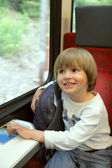 Small boy sits near window in train — Stock Photo
