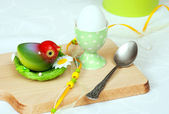 Easter egg with toy bird — Stock Photo