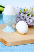 Two eggs on cutting board — Stock Photo