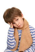The sad child in a long scarf — Stock Photo