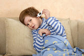 The boy with electronic thermometer — Stock Photo