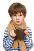 The sick boy with hot cup — Stock Photo