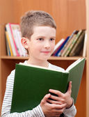 Boy holding book — Stock Photo