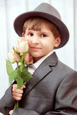Boy holds flowers — Stock Photo