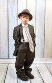 Boy in a big suit — Stock Photo