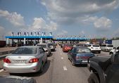 Queue on highway toll gate — Stock Photo
