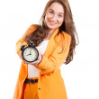 Girl holds in hands alarm clock — Stock Photo #47858347