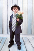 Small boy with bouquet of roses — Stock Photo