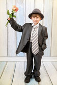 Boy in a stylish suit with roses — Stock Photo