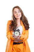 The alarm clock in the girl's hands — Stock Photo