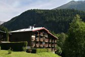 House in Alpin style on slope — Stock Photo