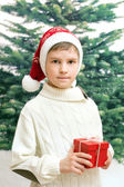Boy holds christmas present — Stock Photo