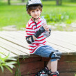 Ittle boy on rollers with a bottle — Stock Photo #50288945