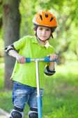 Boy  stands with kick scooter — Stock Photo