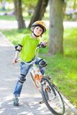 Child with bike stands on cycle lane — ストック写真
