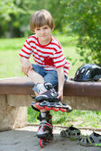 Child put on roller skates — Foto de Stock