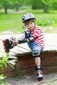 The boy  put on roller skates — Stock Photo