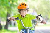 Boy on bicycle — Stock Photo