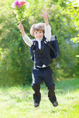 First-grader boy with bouquet — Stockfoto
