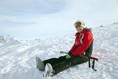 Skier sits — Stock Photo