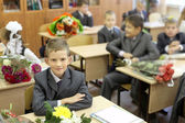 Schoolchilds in classroom on 1 of September — Stock Photo