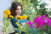 Elina and flower garden — Stockfoto