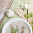 Постер, плакат: Mushroom cream soup served with garlic and greens
