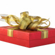Red gift box with gold ribbon. — Stock Photo