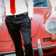 Elegant man with classic car on background — Stock Photo